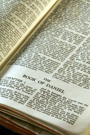 Bible Series. close up detail of antique holy bible open to the book of daniel in the old testament