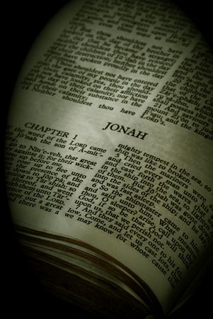 Bible Series. close up detail of antique holy bible open to the book of jonah in the old testament finished in sepia photo