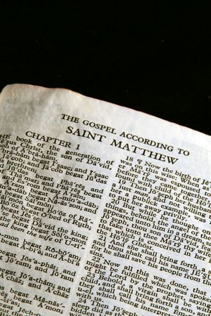 Bible Series. close up detail of antique holy bible open to the gospel according to saint matthew in the new testament photo