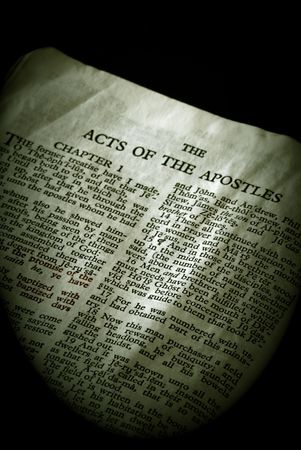 apostles: Bible Series. close up detail of antique holy bible open to the gospel according to the acts of the apostles in the new testament finished in sepia