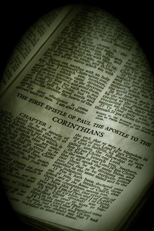 apostle paul: Bible Series. close up detail of antique holy bible open to the gospel according to the first epistle of paul the apostle to the corinthians in the new testament finished in sepia Stock Photo