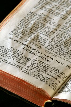 apostle paul: Bible Series. close up detail of antique holy bible open to the gospel according to the first epistle of paul the apostle to the thessalonians in the new testament
