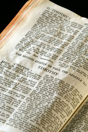 apostle paul: Bible Series. close up detail of antique holy bible open to the gospel according to the second epistle of paul the apostle to Timothy in the new testament