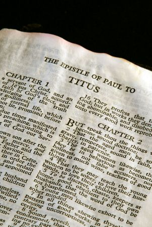 apostle paul: Bible Series. close up detail of antique holy bible open to the gospel according to the epistle of paul the apostle to titus in the new testament