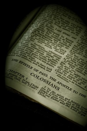 apostle paul: Bible Series. close up detail of antique holy bible open to the gospel according to the epistle of paul the apostle to the colossians in the new testament finished in sepia
