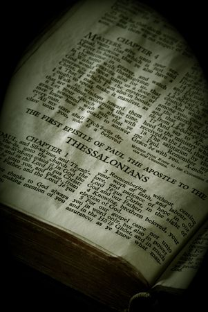 apostle paul: Bible Series. close up detail of antique holy bible open to the gospel according to the first epistle of paul the apostle to the thessalonians in the new testament finished in sepia Stock Photo