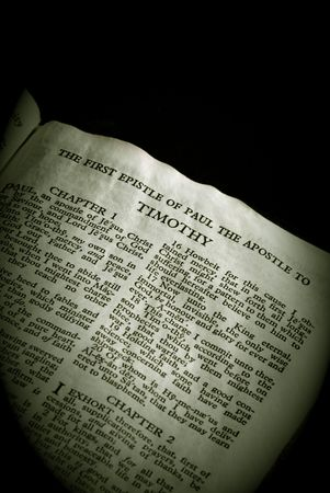 apostle paul: Bible Series. close up detail of antique holy bible open to the gospel according to the first epistle of paul the apostle to timothy in the new testament finished in sepia