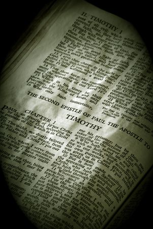 apostle paul: Bible Series. close up detail of antique holy bible open to the gospel according to the second epistle of paul the apostle to Timothy in the new testament finished in sepia