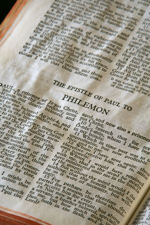 apostle paul: Bible Series. close up detail of antique holy bible open to the gospel according to the epistle of paul the apostle to philemon in the new testament Stock Photo