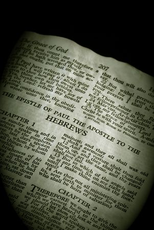 hebrews: Bible Series. close up detail of antique holy bible open to the gospel according to the epistle of paul the apostle to the hebrews in the new testament finished in sepia