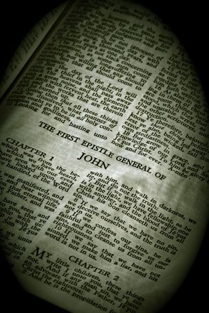 holy bible: Bible Series. close up detail of antique holy bible open to the gospel according to the general epistle of john in the new testament finished in sepia Stock Photo