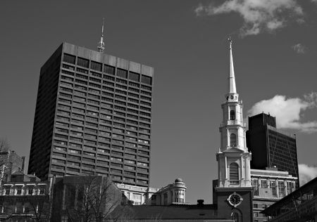 Downtown Boston showing the clock tower and steeple of Park Street Church surrounded by more modern buildings Stock Photo - 2595352