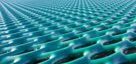 abstract image of green metal grid with lines converging Imagens