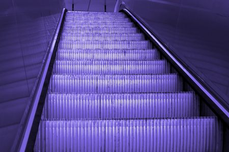 tine: going up a shiny metal staircase, escalator, empty, finished with blue tine