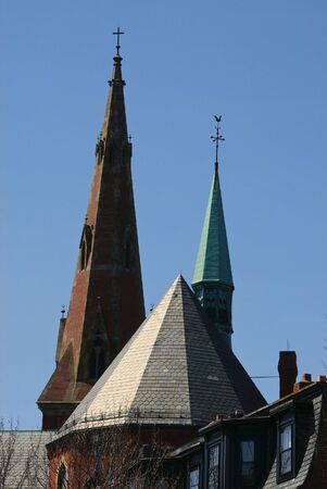 spires: church spires in the sky one with a cross, the other with weather vane