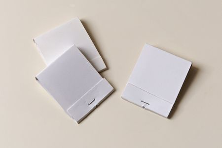 Three White Matchbooks On Off-White Surface, Books are blank to allow text and advertising
