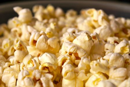 popped: Detail close up of fresh popped buttered popcorn