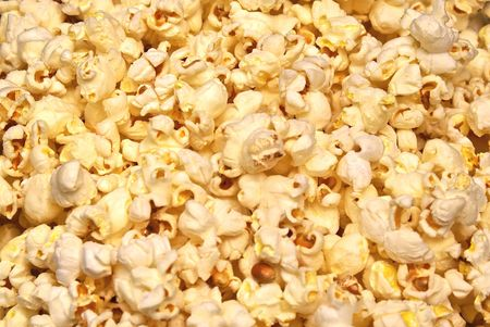 fresh pop corn: Detail close up of fresh popped buttered popcorn