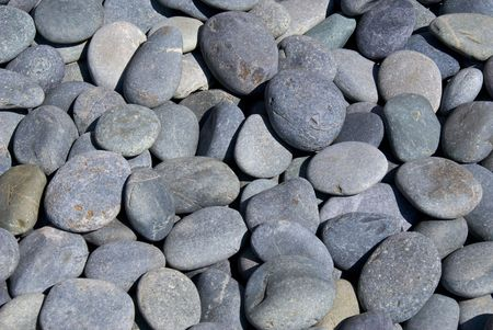 Collection of mostly blu e- grey riverstones filling image, ideal for background