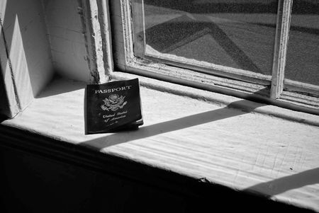 sill: old passport sitting on window sill in the sunshine of an old abandoned house