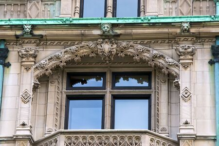 cherubs: detail of The Burrage House Mansion  in boston massachusetts showing the ornate detail and carving of lions, gargoyles, cherubs and more