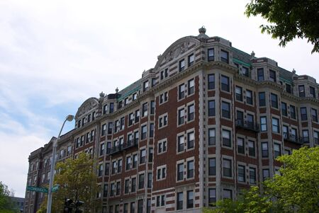 ave: large old brick and stone building on commonwealth ave in kenmore square boston massachusetts framed by trees Stock Photo