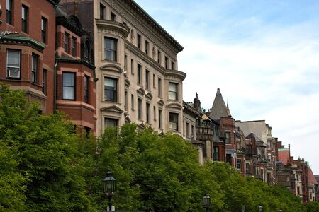 rowhouses: houses and trees along commonwealth avenue in the back bay of boston massachusetts Stock Photo
