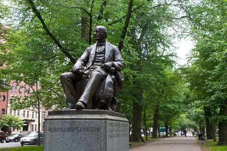 commonwealth: public statue of william lloyd garrison seated in the commonwealth avenue mall in the back bay of boston massachusetts
