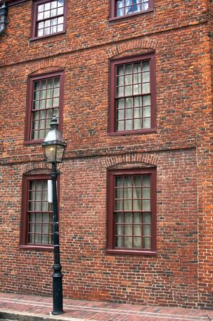 north   end: old brick building with gas light in the north end section of boston massachusetts