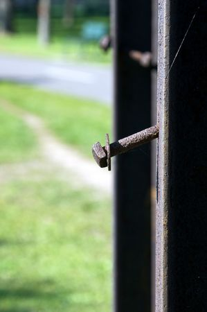 rusted bolt sticking out of rusted metal post