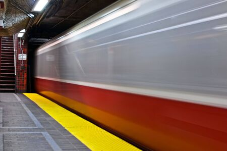 departing: subway train leaving station in boston massachusetts Stock Photo