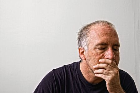 a worried man looking down thinking Stock Photo - 3645548