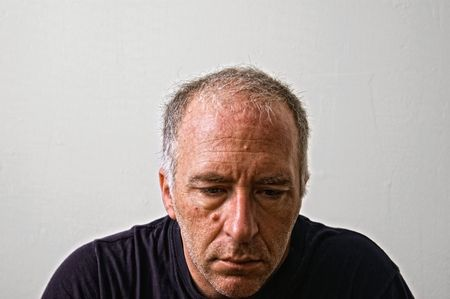 beautifully detailed real portrait of mature unkempt looking adult white man looking down in serious thought Stock Photo - 3655569