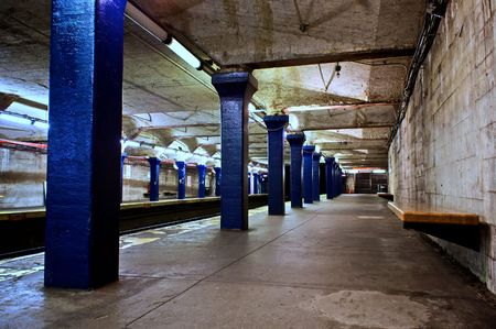 subway platform: old decaying subway station with blue pillars in boston massachusetts