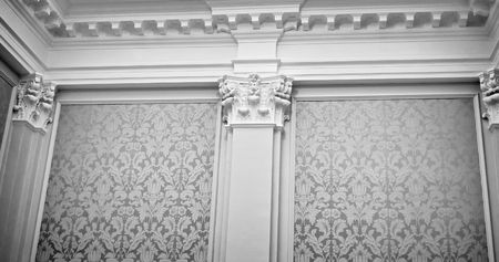 majestic wall covered in fabric, with columns, capitals, crown molding,