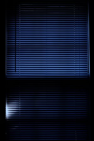 deep rich blue image of mini blinds covering window Stock Photo - 3789395
