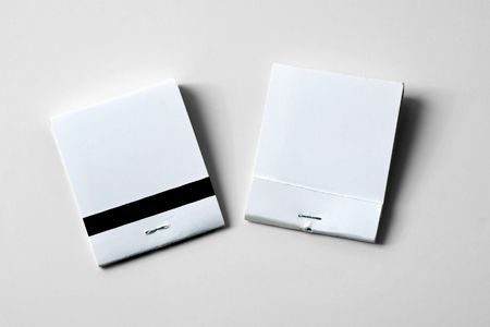 two white blank matchbooks showing front and back on neutral background suitable for copy or adding your own advertising               photo