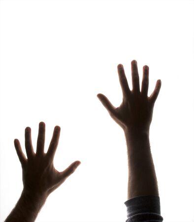backlit: silhouetted parcialmente las manos y con retroiluminaci�n en blanco hasta llegar a como si atrapados Foto de archivo