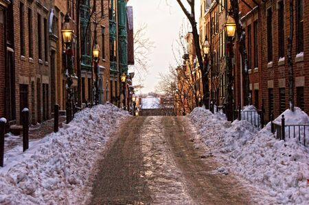 old victorian street on beacon hill in boston massachusetts after a snow storm photo