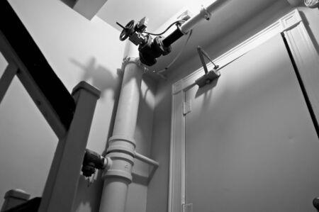 balustrades: focus on sprinkler shut system above door in old stairwell  Stock Photo