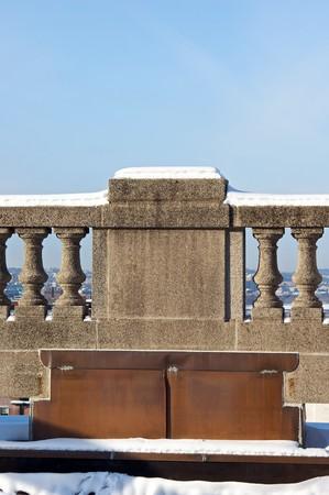snow covered balustrade overlooking boston