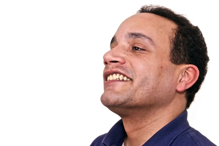 head tilted: african american male wearing blue shirt against white background almost in profile, head tilted back and smiling