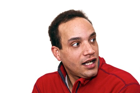 african american male wearing red shirt against white background looking over shoulder with scared expression photo