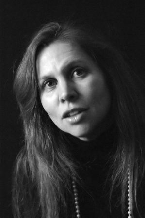 full lips: portrait of pretty mature woman with long hair in black and white with head tilted  full lips and mouth slightly open. side lighting
