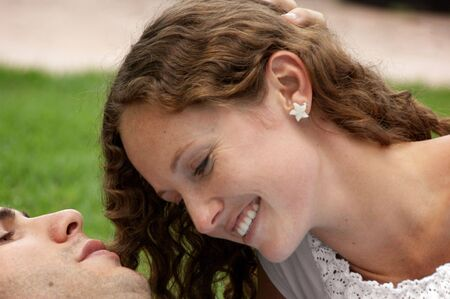 close up of beautiful shy woman with long curly smiling at her lover Stock Photo - 4894128