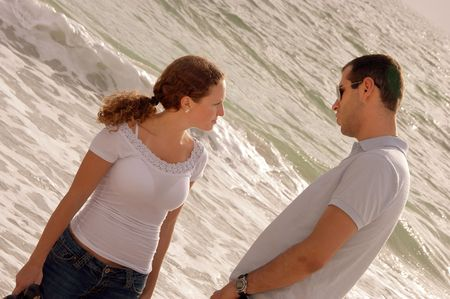 young couple at the beach in the gulf of mexico having a serious talk at the oceanside at that gulf of mexico photo