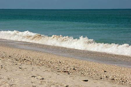 tide: Breaking wave angles across the scene at Bonita Beach Florida. Stock Photo