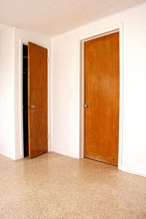 interior room showing two doors one is closed and the other is open slightly. Stock Photo - 5111083