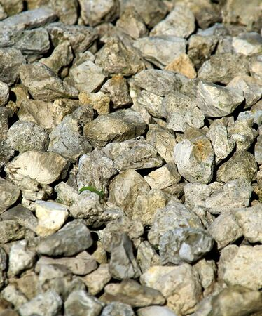 small grey rocks fill this image, suitable as a background