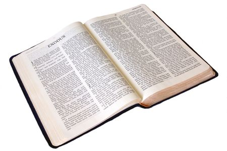 The holy bible is open to the first page of the book of Exodus on white, whole book is shown Stock Photo